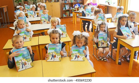 Belarus, Bobruisk district, Sept. 01: First-graders are sitting at school desks in school with donated by books, September 1, 2015 in Bobruisk district, Belarus.