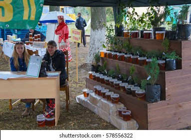 Belarus, Bobruisk district, September 19, 2015: Beekeepers at the fair, presenting their products - fresh, natural honey.