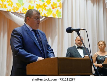 Belarus, Bobruisk District, Telusha Village, November 13, 2015: An important official addresses the speech to the audience in the assembly hall.