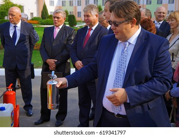 Belarus, Bobruisk district, the village of Slobodka, September 25, 2015: A representative of the delegation holds a small fire extinguisher
