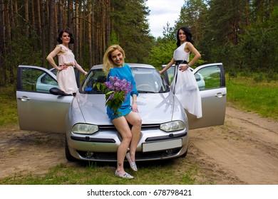 Belarus, Bobruisk, May 20, 2017: Travel by car. Beautiful girls peeking out of open car doors