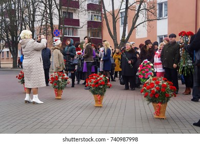 Belarus, Bobruisk, November 7, 2015: People with flowers on the Day of the Great October Revolution came to Lenin Square to lay flowers to the monument
