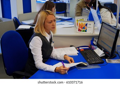 Belarus, Bobruisk, September 24, 2015: The consultant's workplace. Agent tells the terms of the service agreement