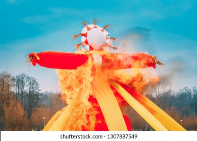 Belarus. Burning Effigies Straw Maslenitsa In Fire On Traditional National Holiday Dedicated To Approach Of Spring - Slavic Celebration Shrovetide.
