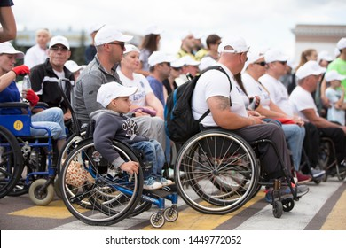 Belarus, the city of Gimel, July 03, 2019. Youth Festival.Marathon Disabled. People in wheelchairs on a city street