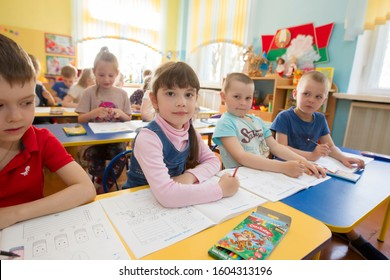 Belarus, the city of Gomel, April 25, 2019. Open day in kindergarten.Children in a lesson in kindergarten. Boy and girls draw.