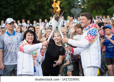 Belarus, the city of Gomel, June 05, 2019. The arrival of fire The Flame of the II European Games.Torchbearers welcome viewers.