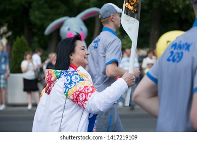 Belarus, the city of Gomel, June 05, 2019. The arrival of fire The Flame of the II European Games.Torchbearer carries the flame through the streets