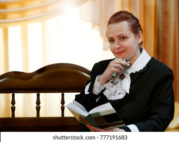 Belarus, the city of Gomel, June 10, 2016. The holiday of the library. An elderly woman with a book. The first teacher. Poetess and writer