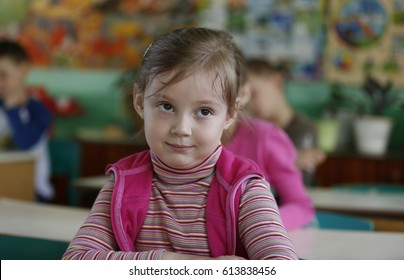 Belarus, the city of Gomel, May 16, 2016. Kindergarten Volotovskaya.Beautiful girl, child is sitting at the table, smiling