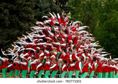 Belarus, the city of Gomel, May 9, 2017. The Victory Day. A living pyramid of people. Colorful structure of human bodies. Flashmob.Mass of people.Holiday in the zone of radioactive contamination