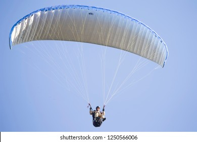 Belarus city Gomel October 7, 2018. Performances on paragliding.A paraglider flies in the sky under a multi-colored paraglider.Man under parachute