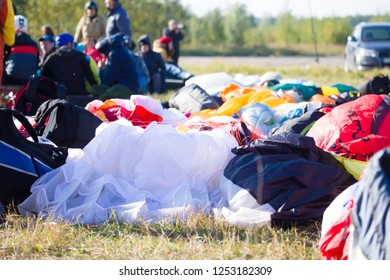 Belarus city Gomel October 7, 2018. Performances on paragliding.Paragliders lie on the ground against the backdrop of paragliders.