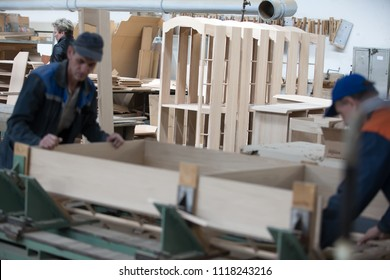 Belarus, the city of Gomel, on April 26, 2018. Furniture factory. Shop for wood processing and furniture manufacturing. Workers make furniture cabinets