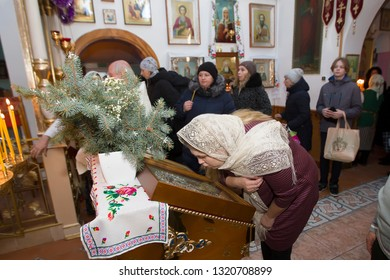 Belarus, the city of Gomel, Prudkovskaya church. January 19, 2019.The celebration of the baptism of Jesus. Russian woman kisses the icon in the Orthodox Church