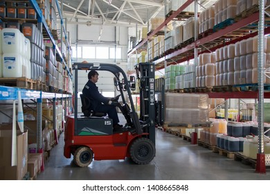 Belarus, the city of Mensk, April 12, 2019. Chemical production.Worker on a loader in a warehouse