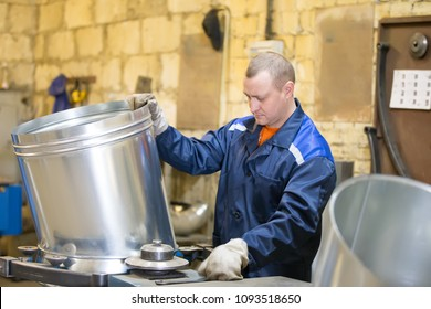 Belarus, Gomel, 25 April 2018. Factory for the manufacture of ventilation pipes.The worker at the factory makes ventilating metal pipes