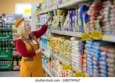 Belarus, Gomel, April 24, 2018. The shop is central. Saleswoman in a supermarket near the shelf with food