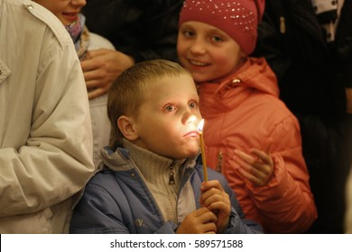 Belarus, Gomel city, celebrating the church holiday of Easter in St. Nicholas Monastery 01.05. 2016 year. A child is a boy in a church for Easter. A boy is holding a candleh