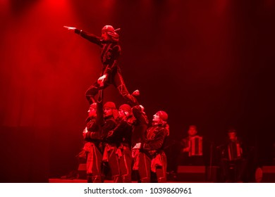 Belarus, Gomel, February 27, 2018. Concert hall. Speech of the national Georgian ballet Sukhishvili.Georgian dancers performing red-lighted dance on stage