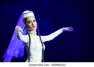 Belarus, Gomel, February 27, 2018. Concert hall. Speech of the national Georgian ballet Sukhishvili.A Georgian woman in a national white costume dances Georgian dance
