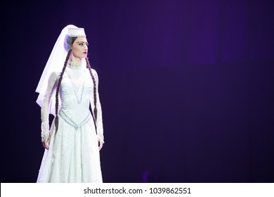 Belarus, Gomel, February 27, 2018. Concert hall. Speech of the national Georgian ballet Sukhishvili.A Georgian woman in a national white costume dances Georgian dance