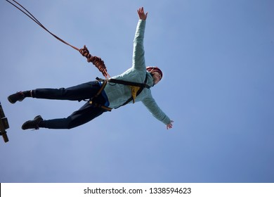 Belarus, Gomel, March 08, 2019. Jumping from the bridge to the rope.Ropejumping.Dangerous hobbies.Extreme man jumps from a great height