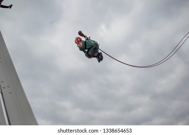 Belarus, Gomel, March 08, 2019. Jumping from the bridge to the rope.Ropejumping.A man jumps from a great height and flies on the rope in the sky. Extreme passion