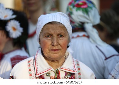 Belarus, Gomel, May 20, 2017.Belarus, Gomel, May 20, 2017. Holiday in the branch of the Vetkovsky Museum.Old woman in scarf and national clothes.Belarusian grandmother. Old Slavs