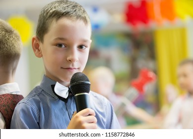 Belarus, Gomel, May 24 2018. The kindergarten is central. Open Day.Boy preschooler with microphone.A child is singing a song