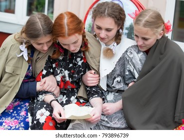 Belarus, Gomel, May 9, 2017. Victory Day. Central Street. Girls read a paper letter