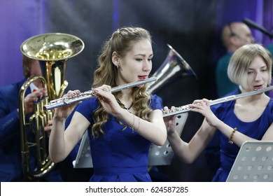 Belarus, Gomel, the performance of the Gomel city orchestra. March 29, 2017.Girl playing the flute.Play music. Play the flute. The girl in the orchestra