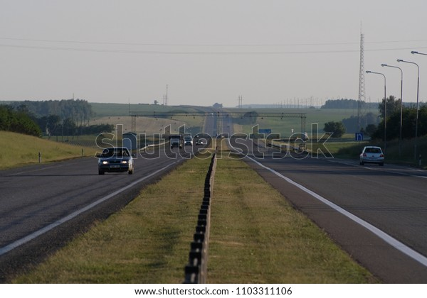 Belarus - May, 29, 2018: landscape with the image of traffic on a highway in Belarus