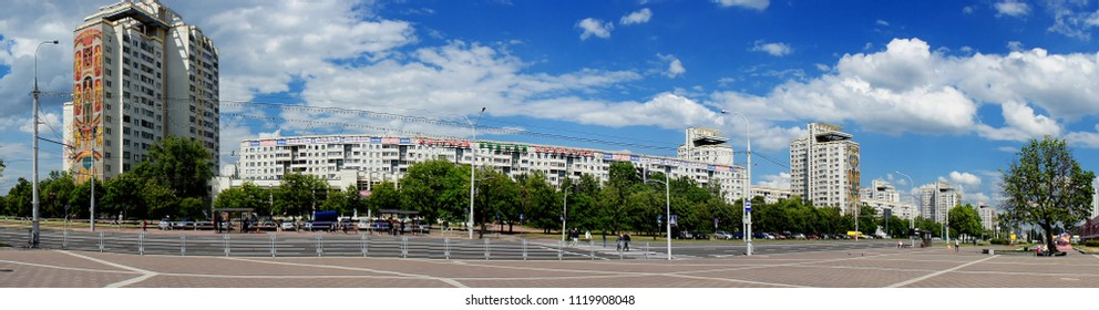 """Belarus, Minsk, 05-25-2018, panoramic view of the buildings of the architectural complex """"Vostok"""" on Independence Avenue on the background of the blue sky, the river, the Promenade, the editorial"""