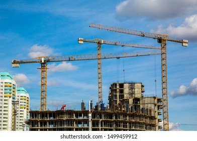 Belarus, Minsk, 09/30/2018; Modern civil engineering, industrial tower cranes against a blue sky; Modern city landscape, editorial
