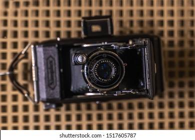 Belarus,  Minsk, 13.09.2019, Museum of Great Patriotic War. old vintage camera. old retro technology. Zeiss Ikon camera. Nettar Anastigmat. top view.