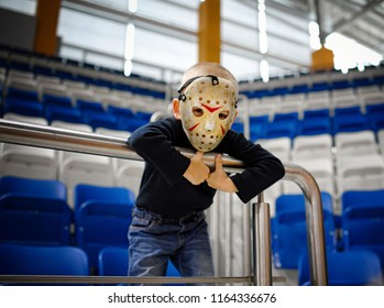 Belarus, Minsk - 22 oct 2016. UNICON Convention. Ð¡hild in the  scary hockey mask of Jason Voorhees  from the movie Friday 13. Vintage style scary mask.