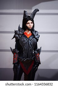 Belarus, Minsk - 22 oct 2016. UNICON Convention. Cosplayer dressed as character Neltharion, Lady Deathwing from game World of Warcraft poses.