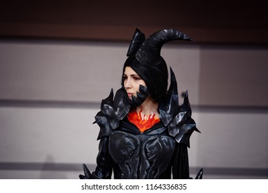 Belarus, Minsk - 22 oct 2016. UNICON Convention. Cosplayer dressed as character Neltharion, Deathwing from game World of Warcraft poses.