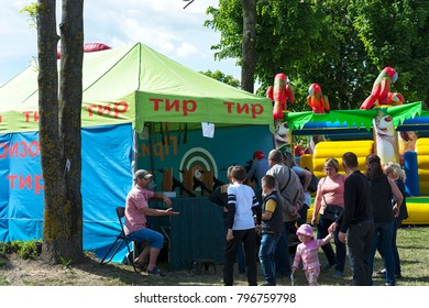 "Belarus, Minsk - 27.05.2017: the tent with the inscription ""TIR"" were people shooting from the pneumatic weapon"