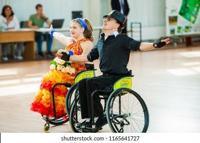Belarus, Minsk, August 25, 2018:  couple dancers perform championship  dances  wheelchairs