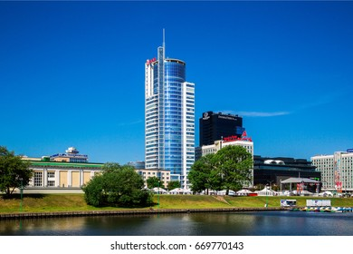 Belarus, Minsk, July 1, 2017: View of the city of Minsk from the embankment of the Svisloch River in the background of the Royal Plaza business center and the Minsk-Mobil MALL GALLERY, editorial