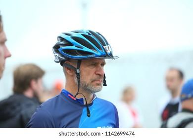 Belarus, Minsk, July 22, 2018: man athletes warm up at the start of the Minsk Triathlon