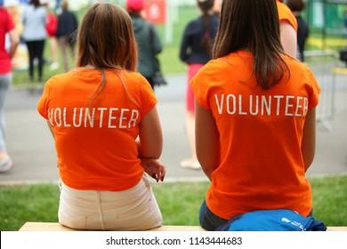 Belarus, Minsk, July 22, 2018: Volunteer girls work in triathlon competitions.
