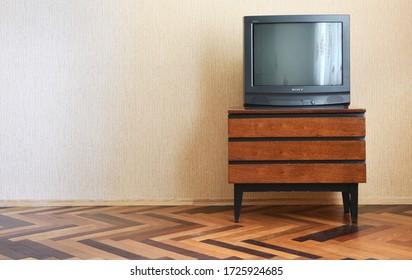 Belarus, Minsk - June 03, 2019Vintage Television on wooden antique closet, old design in a home. Sony trinitron kv-21m3