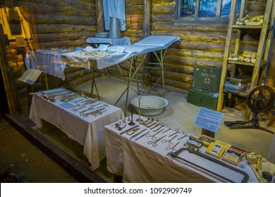 BELARUS, MINSK - MAY 01, 2018: Indoor view of tools used during medical practice during war, inside of small huts of atention in Great Patriotic War exhibits of the museum, in Minsk