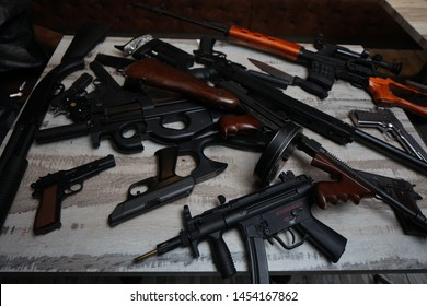 Belarus, Minsk, November 2015. collection of various weapons lies on the table rifles and submachine guns.