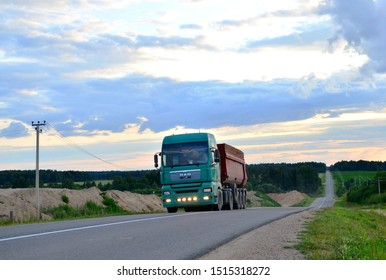 BELARUS, MINSK REGION - JUL 13, 2019: MAN rear dump trailer truck semi driving along highway