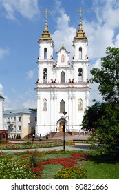 Belarus nice Vitebsk summer landscape view of restored cathedral and bright flowers