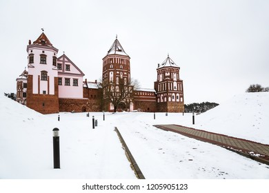 Belarusian attraction Mir Castle covered with snow in the winter season.